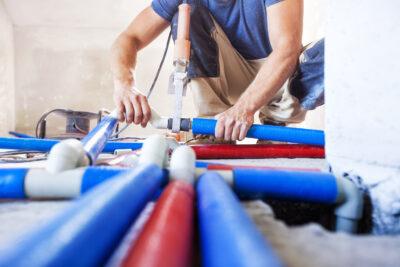 Man repairing pipes